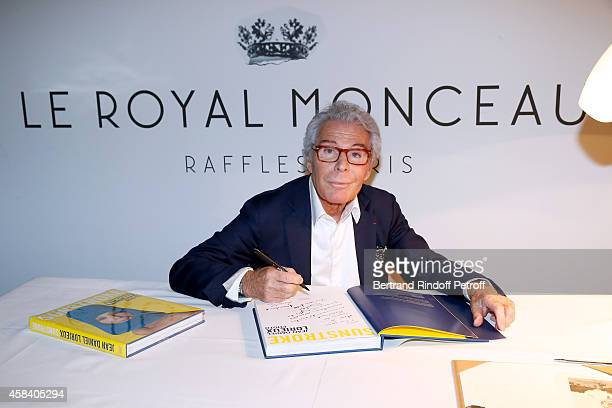 JeanDaniel Lorieux signs his Book 'Sunstroke' at the Art Bookshop of the 'Royal Monceau Raffles Paris' on November 4 2014 in Paris France
