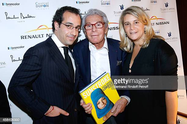 JeanDaniel Lorieux standing between Lawyer Gregory Levy and his wife Lawyer Leslie Dickstein attend JeanDaniel Lorieux signs his Book 'Sunstroke' at...