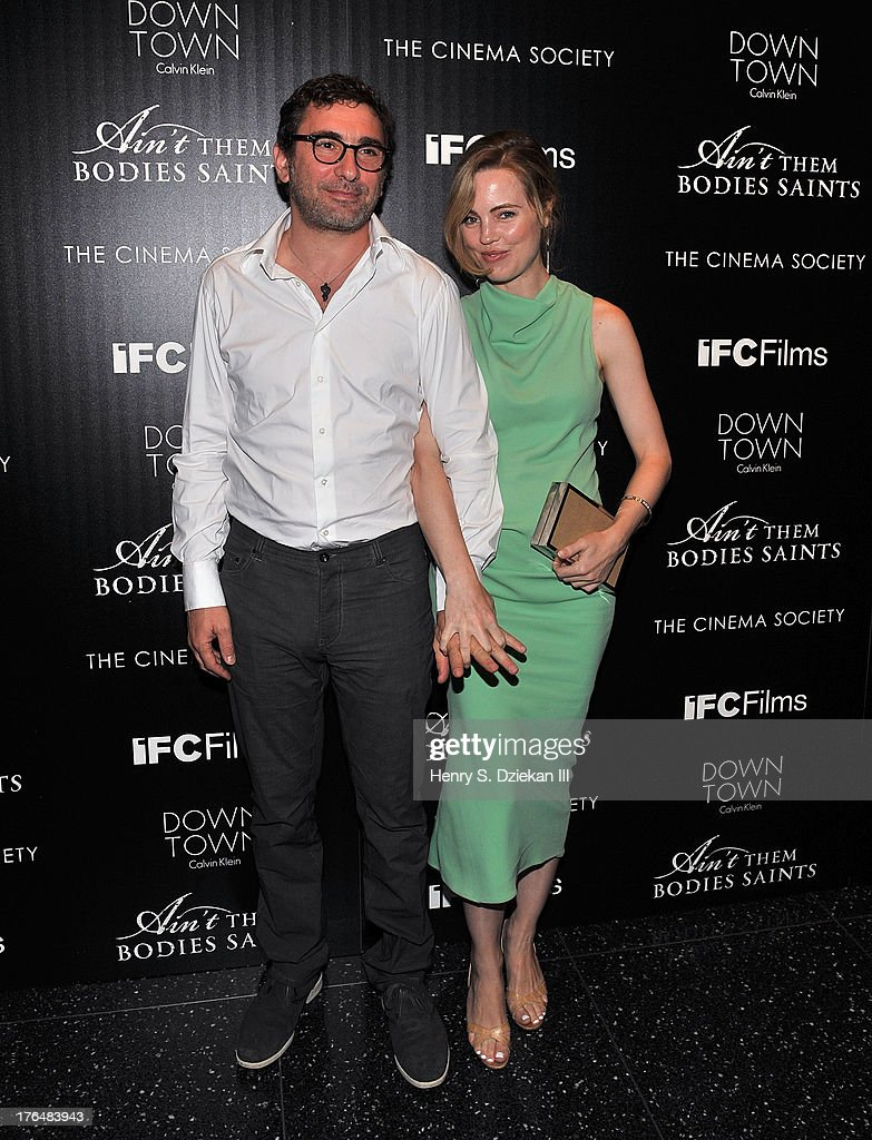 Jean-David Blanc and <a gi-track='captionPersonalityLinkClicked' href=/galleries/search?phrase=Melissa+George&family=editorial&specificpeople=201840 ng-click='$event.stopPropagation()'>Melissa George</a> attend the Downtown Calvin Klein with The Cinema Society screening of IFC Films' 'Ain't Them Bodies Saints' at Museum of Modern Art on August 13, 2013 in New York City.