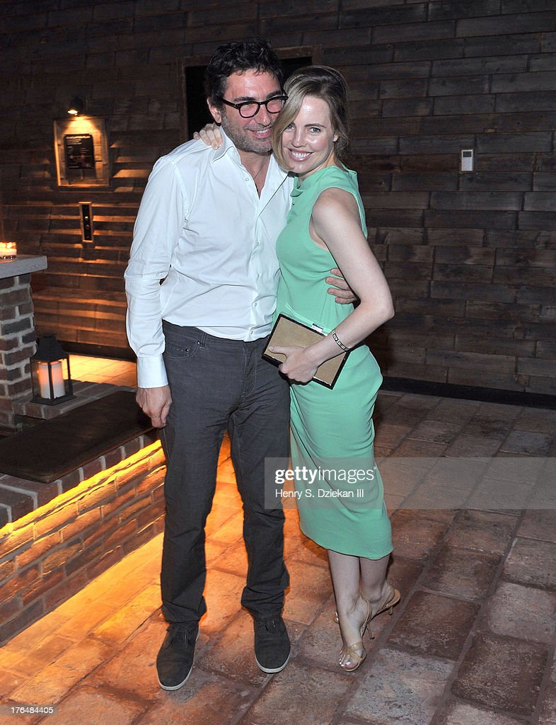 Jean-David Blanc and <a gi-track='captionPersonalityLinkClicked' href=/galleries/search?phrase=Melissa+George&family=editorial&specificpeople=201840 ng-click='$event.stopPropagation()'>Melissa George</a> attend the Downtown Calvin Klein with The Cinema Society screening of IFC Films' 'Ain't Them Bodies Saints' after party at Refinery Rooftop on August 13, 2013 in New York City.