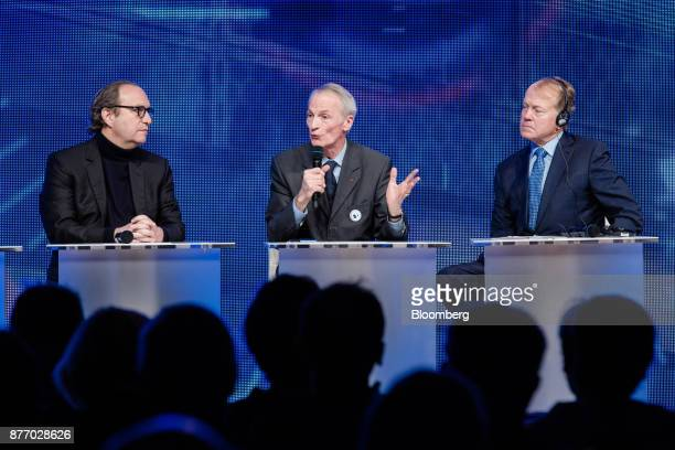 JeanDominique Senard chief executive officer of Michelin Cie center speaks as Xavier Niel billionaire and deputy chairman of Iliad SA left and John...