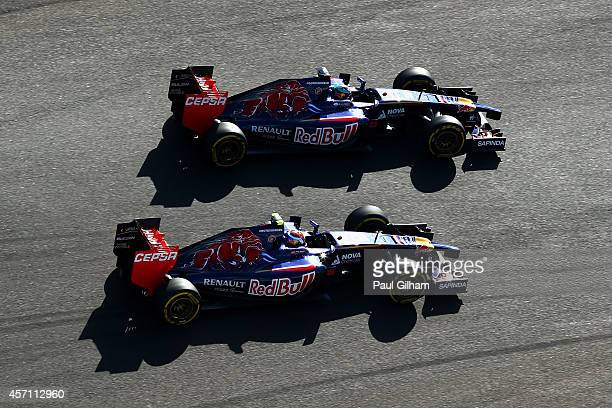 JeanEric Vergne of France and Scuderia Toro Rosso and Daniil Kvyat of Russia and Scuderia Toro Rosso drive during the Russian Formula One Grand Prix...