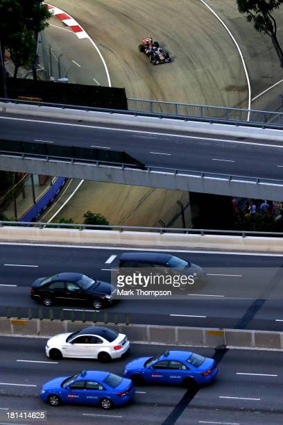 JeanEric Vergne of France and Scuderia Toro Rosso drives during qualifying for the Singapore Formula One Grand Prix at Marina Bay Street Circuit on...