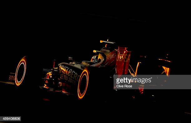 JeanEric Vergne of France and Scuderia Toro Rosso drives during qualifying for the Abu Dhabi Formula One Grand Prix at Yas Marina Circuit on November...
