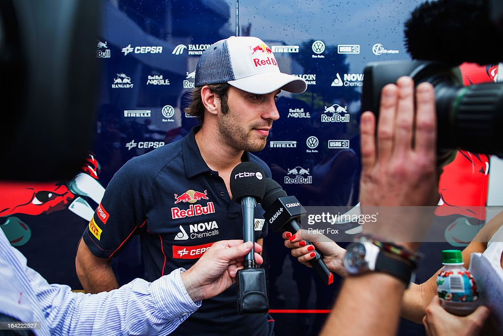 Jean-Eric Vergne of France and Scuderia Toro Rosso is interviewed in the paddock during previews to the Malaysian Formula One Grand Prix at the Sepang Circuit on March 21, 2013 in Kuala Lumpur, Malaysia.