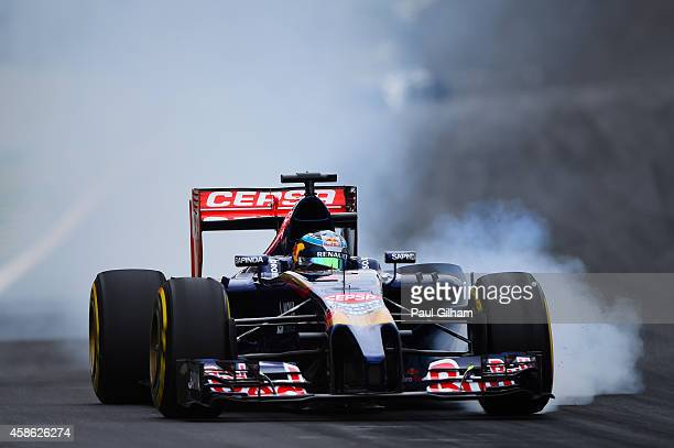 JeanEric Vergne of France and Scuderia Toro Rosso locks up during qualifying for the Brazilian Formula One Grand Prix at Autodromo Jose Carlos Pace...
