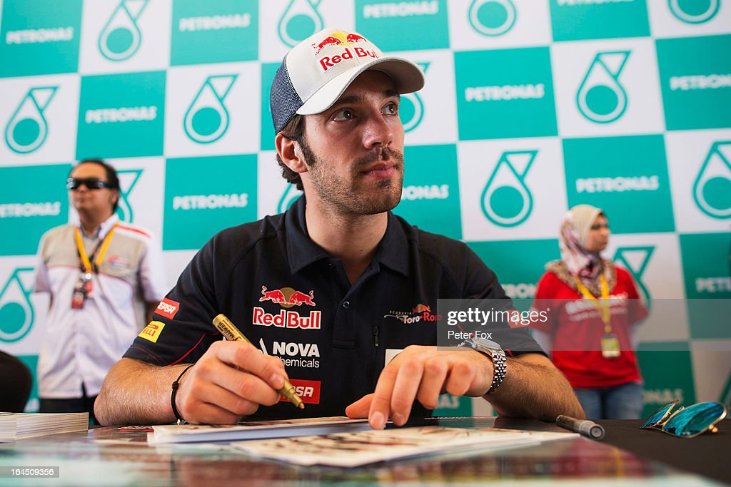Jean-Eric Vergne of France and Scuderia Toro Rosso signs autographs for fans before the Malaysian Formula One Grand Prix at the Sepang Circuit on March 24, 2013 in Kuala Lumpur, Malaysia.