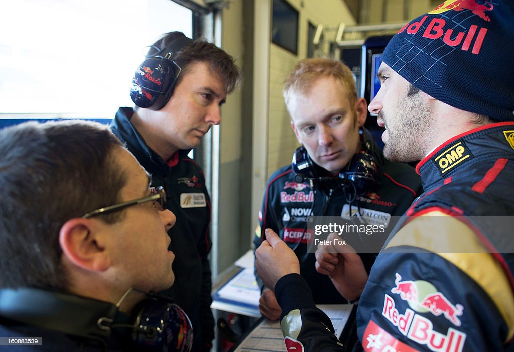Jean-Eric Vergne (R) of France and Scuderia Toro Rosso speaks with James Key (2nd L) the Scuderia Toro Rosso Technical Director and Phil Charles the Scuderia Toro Rosso Race Engineer in the team garage during Formula One winter testing at Circuito de Jerez on February 7, 2013 in Jerez de la Frontera, Spain.