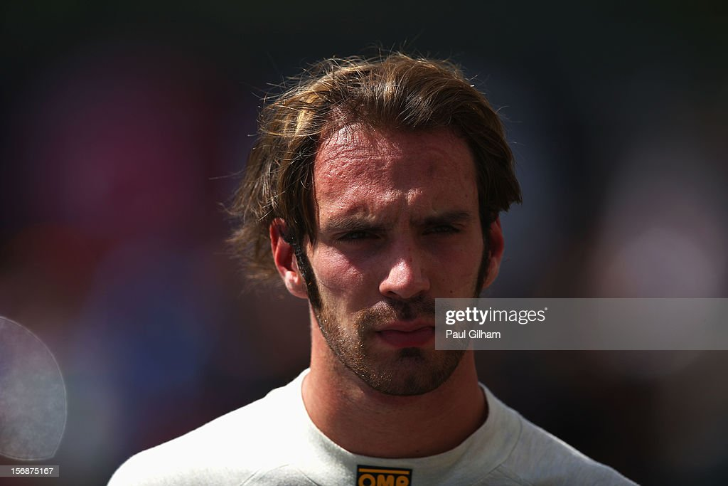 Jean-Eric Vergne of France and Scuderia Toro Rosso walks in the paddock following practice for the Brazilian Formula One Grand Prix at the Autodromo Jose Carlos Pace on November 23, 2012 in Sao Paulo, Brazil.