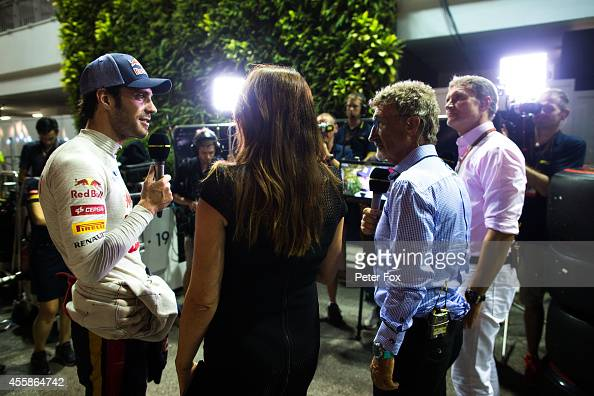 JeanEric Vergne of Toro Rosso and France being interviewed by the BBC after finishing 6th in the Singapore F1 Grand Prix at Marina Bay Street Circuit...