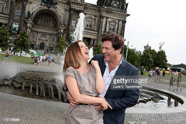 Jeanette Biedermann and Francis FultonSmith attend the 'Jedermann' Photocall near the Berlin Cathedral Church on August 7 2013 in Berlin Germany