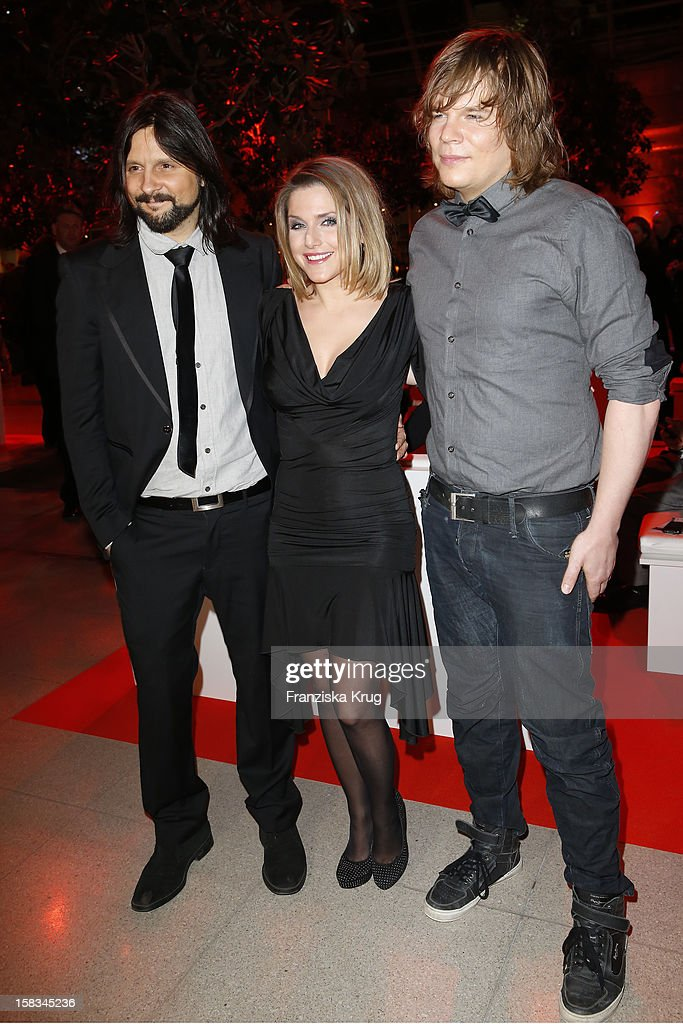Jeanette Biedermann and her husband Joerg Weisselberg and Christian Boemkes attend the 18th Annual Jose Carreras Gala on December 13, 2012 in Leipzig, Germany.