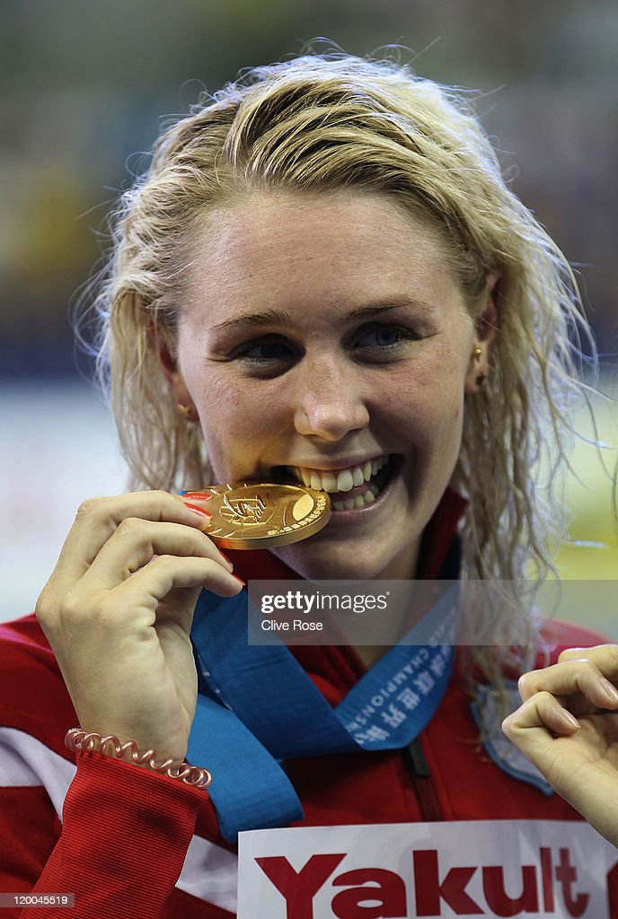 Jeanette Ottesen of Denmark celebrates winning the gold medal tied with Aliaksandra Herasimenia of Belarus after the Women's 100m Freestyle Final during Day Fourteen of the 14th FINA World Championships at the Oriental Sports Center on July 29, 2011 in Shanghai, China.