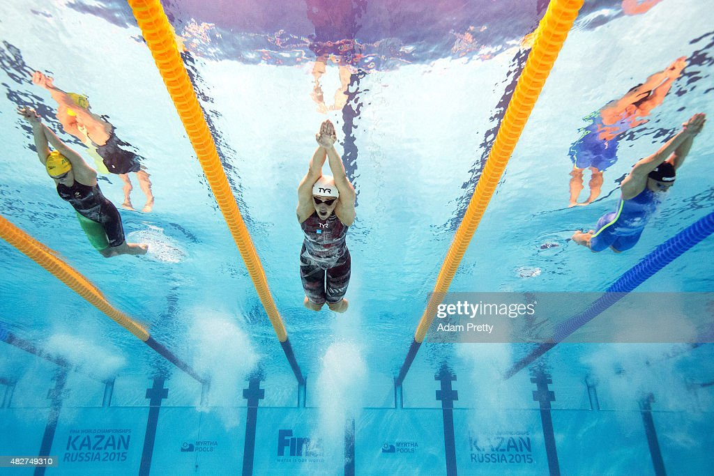 Jeanette Ottesen (C) of Denmark competes in the Women's 100m Butterfly Heats on day nine of the 16th FINA World Championships at the Kazan Arena on August 2, 2015 in Kazan, Russia.