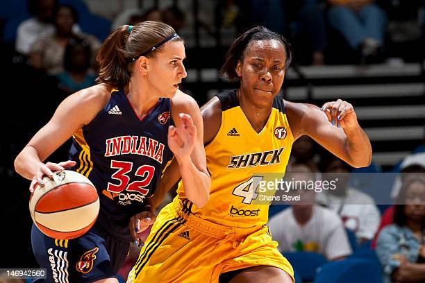 Jeanette Pohlen of the Indiana Fever moves the ball against Amber Holt of the Tulsa Shock during the WNBA game on June 23 2012 at the BOK Center in...