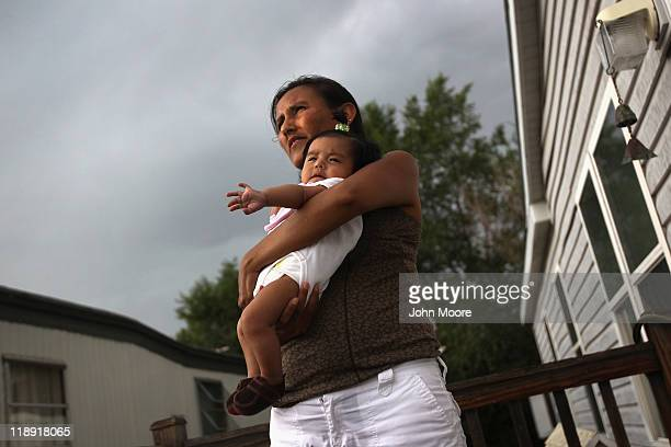 Jeanette Vizguerra an undocumented immigrant from Mexico holds her daughter Zury 5 months on July 10 2011 in Denver Colorado Vizguerra has four...