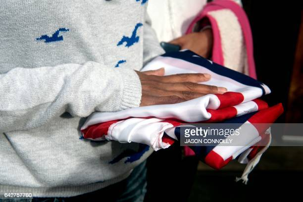 Jeanette Vizguerra an undocumented Mexican mother of three US born children rests her hands on an American flag while speaking to supporters gathered...