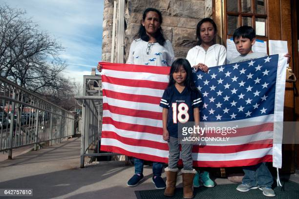 Jeanette Vizguerra and her three US born children Luna Roberto and Zury Baez stand outside the First Unitarian Church in Denver Colorado on February...
