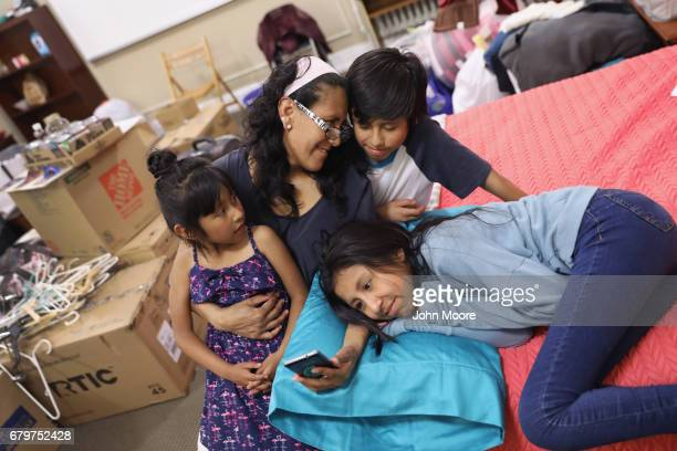 Jeanette Vizguerra sits with her USborn children Zury Roberto and Luna 12 while taking sanctuary at the First Baptist Church on May 5 2017 in Denver...