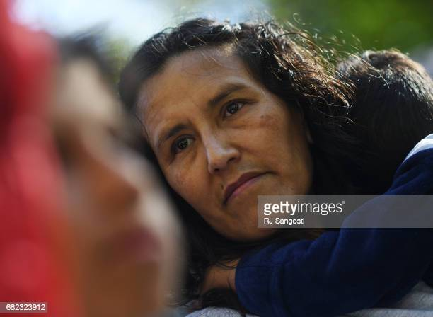 Jeanette Vizguerra who is in the US illegally and has taken sanctuary at First Baptist Church of Denver holds her son Santiago on May 12 2017 in...