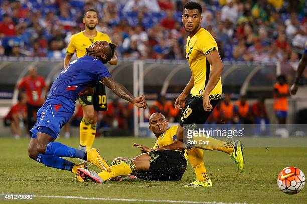 JeanEudes Maurice of Haiti tangles with Rodolph Austin of Jamaica during the second half of the 2015 CONCACAF Gold Cup quarterfinal match at MT Bank...