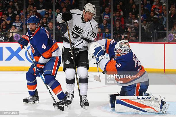 JeanFrancois Berube of the New York Islanders makes a save Dennis Seidenberg and Tanner Pearson of the Los Angeles Kings looks on at the Barclays...