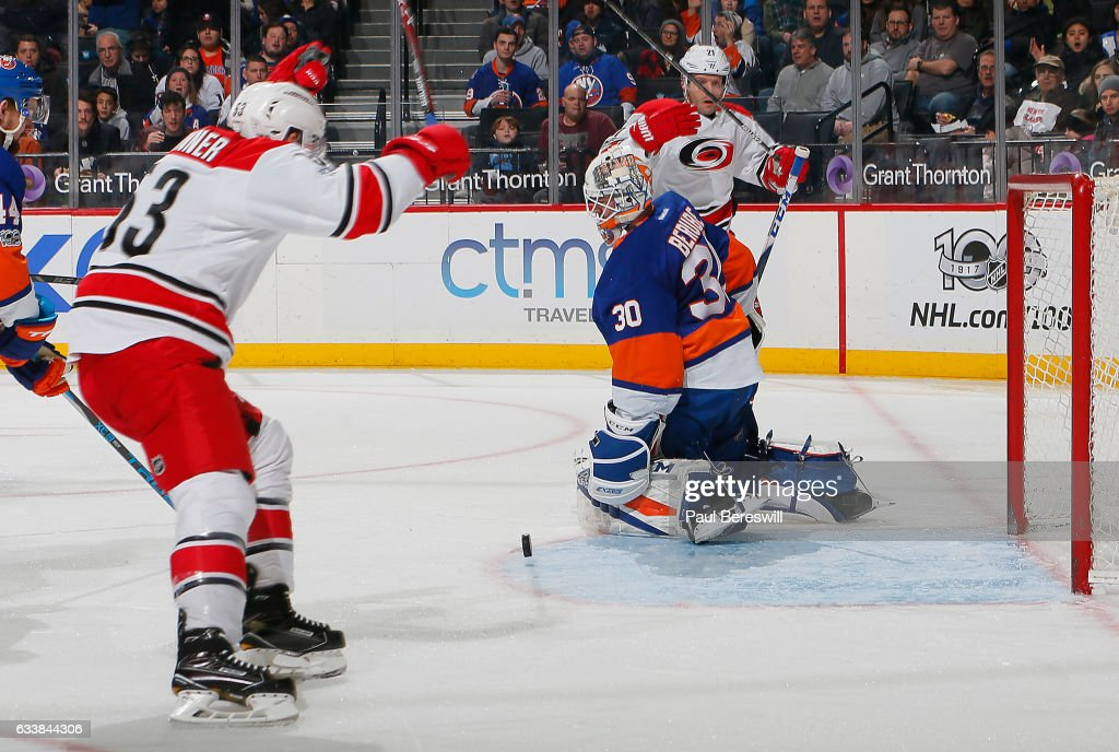 Jean-Francois Berube #30 of the New York Islanders reacts as Jeff Skinner #53 celebrates a second period goal by Lee Stempniak #21 of the Carolina Hurricanes at Barclays Center on February 4, 2017 in the Brooklyn borough of New York City.