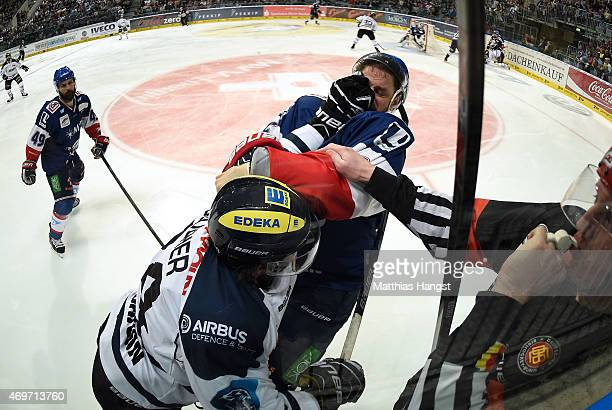 JeanFrancois Boucher of Ingolstadt gets in a scuffle with Kurtis Foster of Mannheim during the DEL Playoffs Final Game 3 between Adler Mannheim and...