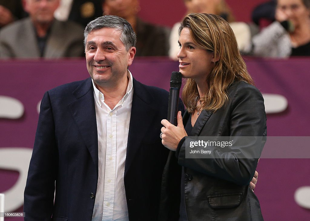 Jean-Francois Cirelli, Vice-Chairman and President of GDF Suez and <a gi-track='captionPersonalityLinkClicked' href=/galleries/search?phrase=Amelie+Mauresmo&family=editorial&specificpeople=161389 ng-click='$event.stopPropagation()'>Amelie Mauresmo</a>, director of the tournament during the trophy ceremony after the final of the Open GDG Suez 2013 at the Stade Pierre de Coubertin on February 3, 2013 in Paris, France.
