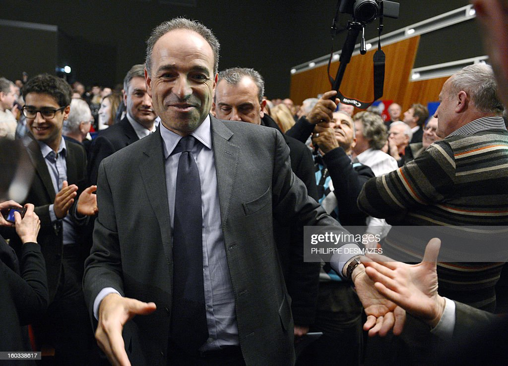 Jean-Francois Cope, the head of France's right-wing UMP opposition, gestures as he arrives to give a speech during a meeting with militants on January 29, 2013 in Villeurbanne near Lyon.