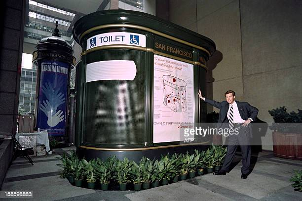 JeanFrancois Decaux Chief Executive Officer of JC Decaux stands with his company's UniversallyAccessible Automatic Public Toilet and kiosk newsstand...