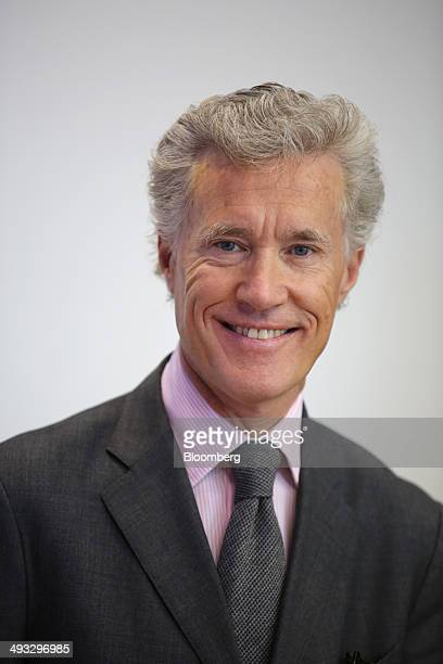 JeanFrancois Decaux cochief executive officer of JCDecaux SA poses for a photograph following a Bloomberg Television interview at the St Petersburg...