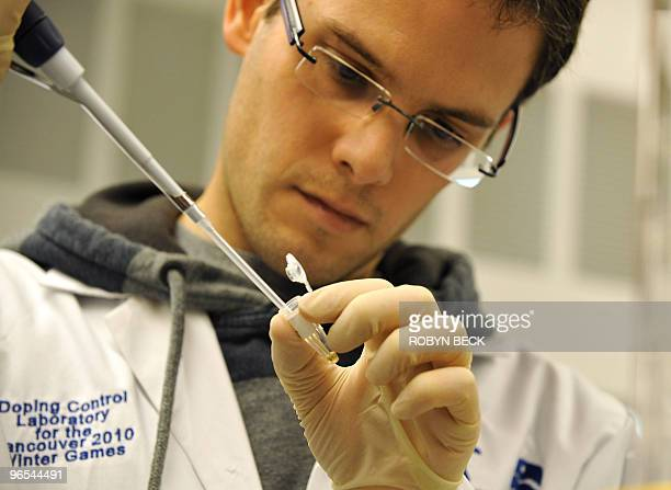 JeanFrancois Naud prepares a sample for testing at the Doping Control Laboratory for the 2010 Winter Olympic Games at the Richmond Oval in Richmond...