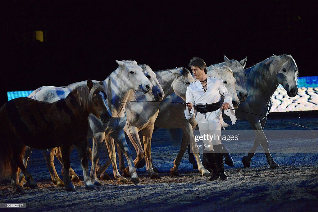 Jean-Francois Pignon and his trained horses perform during the Horse Music Show as part of Gucci Paris Masters 2013 - Day 1 at Paris Nord Villepinte on December 5, 2013 in Paris, France.