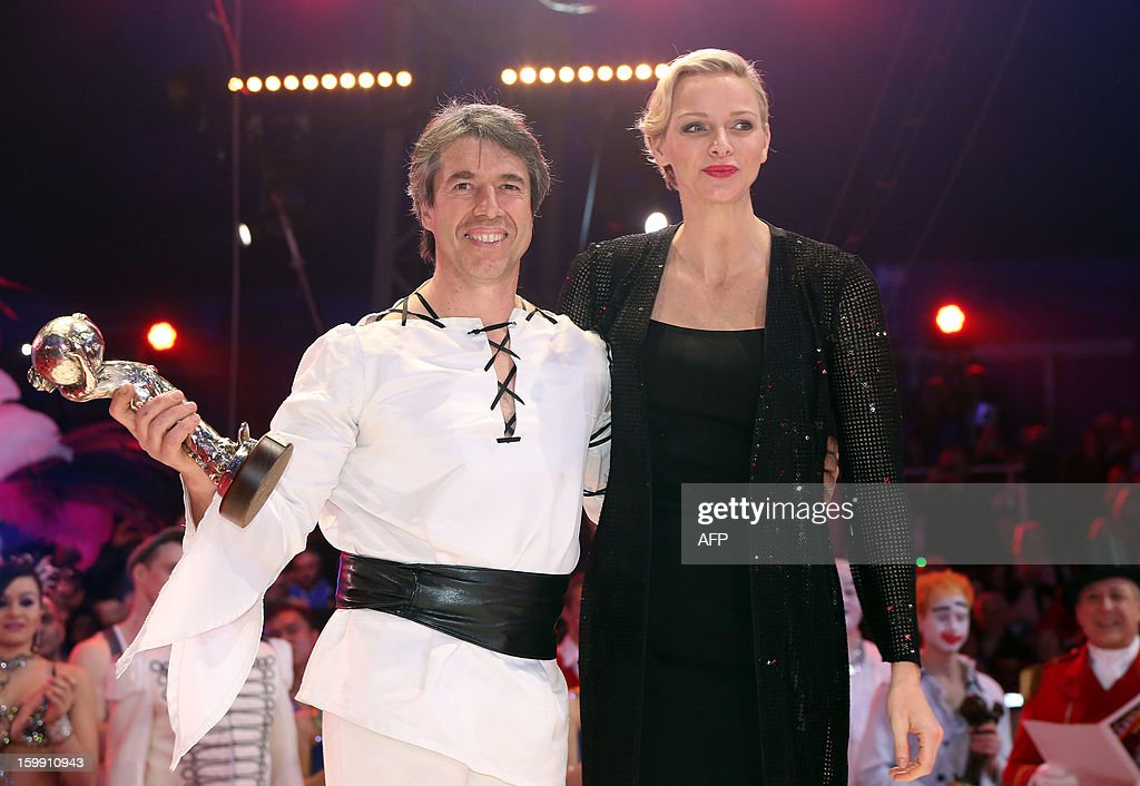 Jean-Francois Pignon from France receives the 'Silver Clown' award from Princess Charlene of Monaco during the official Award Gala Evening of the 37th International Circus Festival of Monte Carlo in Monaco, 22 January 2013. AFP PHOTO POOL SEBASTIEN NOGIER