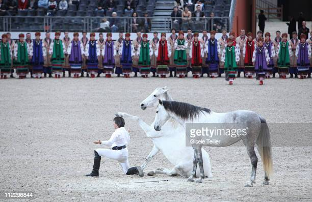 JeanFrancois Pignon performs with his horse at the Saut Hermes International Show Jumping Competition at the Grand Palais on April 15 2011 in Paris...
