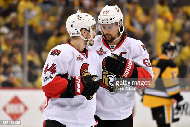 JeanGabriel Pageau and Erik Karlsson of the Ottawa Senators talk during a break in play against the Pittsburgh Penguins in Game Seven of the Eastern...