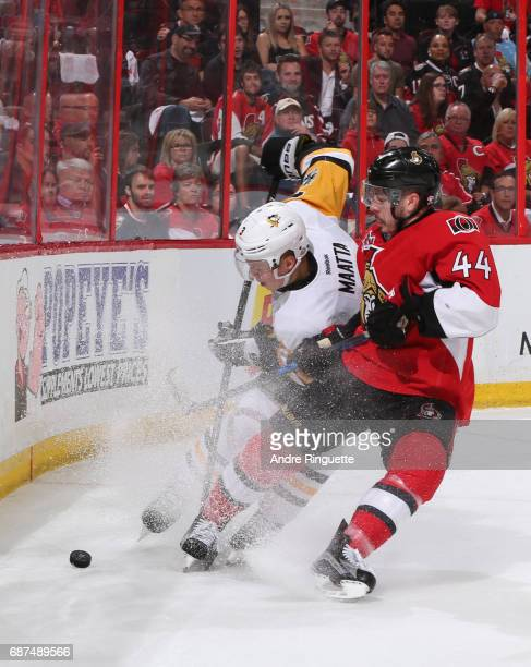 JeanGabriel Pageau of the Ottawa Senators battles for a loose puck with Olli Maatta of the Pittsburgh Penguins in Game Six of the Eastern Conference...