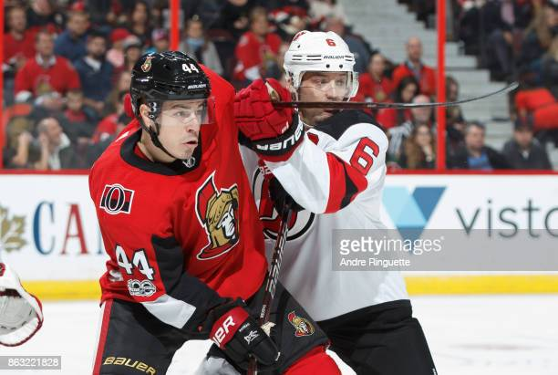JeanGabriel Pageau of the Ottawa Senators battles for position against Andy Greene of the New Jersey Devils at Canadian Tire Centre on October 19...