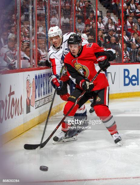 JeanGabriel Pageau of the Ottawa Senators battles for puck possession against John Carlson of the Washington Capitals at Canadian Tire Centre on...