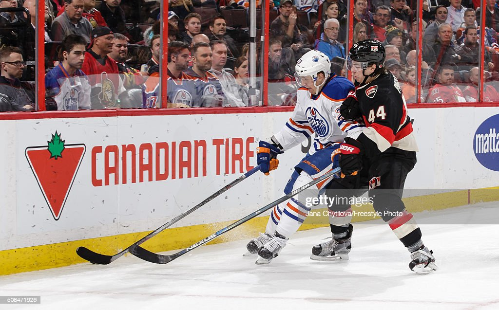 Jean-Gabriel Pageau #44 of the Ottawa Senators battles for the loose puck against Lauri Korpikoski #28 of the Edmonton Oilers during an NHL game at Canadian Tire Centre on February 4, 2016 in Ottawa, Ontario, Canada.