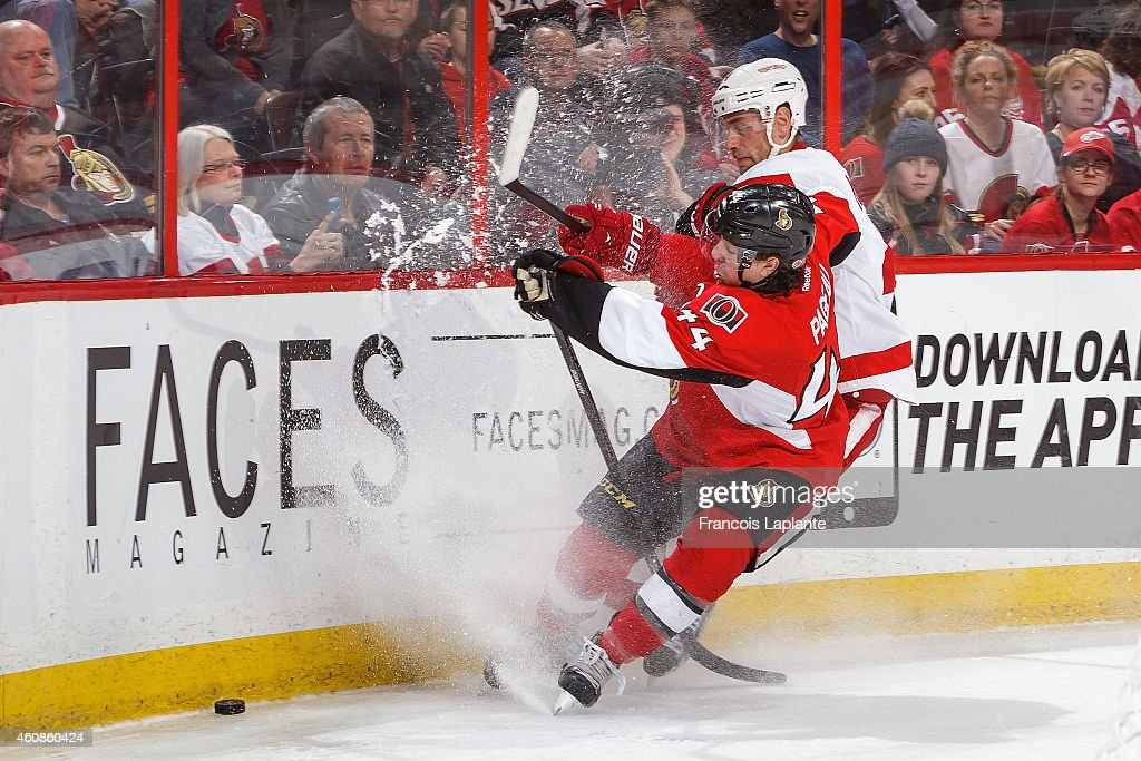 <a gi-track='captionPersonalityLinkClicked' href=/galleries/search?phrase=Jean-Gabriel+Pageau&family=editorial&specificpeople=7895476 ng-click='$event.stopPropagation()'>Jean-Gabriel Pageau</a> #44 of the Ottawa Senators battles for the puck against <a gi-track='captionPersonalityLinkClicked' href=/galleries/search?phrase=Jakub+Kindl&family=editorial&specificpeople=716743 ng-click='$event.stopPropagation()'>Jakub Kindl</a> #4 of the Detroit Red Wings at Canadian Tire Centre on December 27, 2014 in Ottawa, Ontario, Canada.