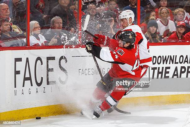 JeanGabriel Pageau of the Ottawa Senators battles for the puck against Jakub Kindl of the Detroit Red Wings at Canadian Tire Centre on December 27...