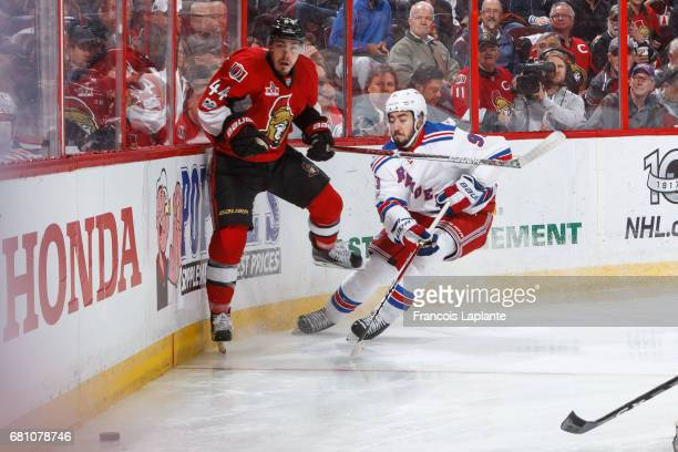 JeanGabriel Pageau of the Ottawa Senators battles for the puck against Mika Zibanejad of the New York Rangers in Game Five of the Eastern Conference...