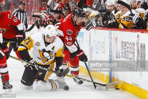 JeanGabriel Pageau of the Ottawa Senators battles for the puck against Evgeni Malkin of the Pittsburgh Penguins in Game Three of the Eastern...