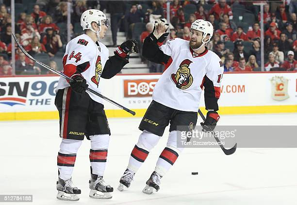 JeanGabriel Pageau of the Ottawa Senators celebrates his emtynet goal in the third period with Zack Smith during their NHL game against the Calgary...