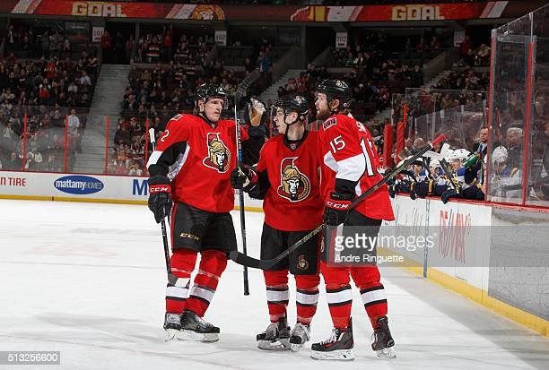 JeanGabriel Pageau of the Ottawa Senators celebrates his first of two 3rd period goals against the St Louis Blues with teammates Dion Phaneuf and...
