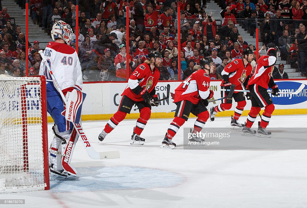 JeanGabriel Pageau of the Ottawa Senators celebrates his first period shorthanded goal against Ben Scrivens of the Montreal Canadiens with teammates...
