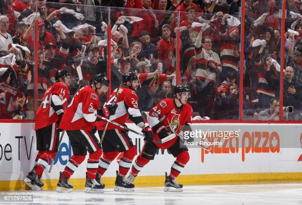 JeanGabriel Pageau of the Ottawa Senators celebrates his second period goal against the Boston Bruins with teammates Alexandre Burrows Cody Ceci and...
