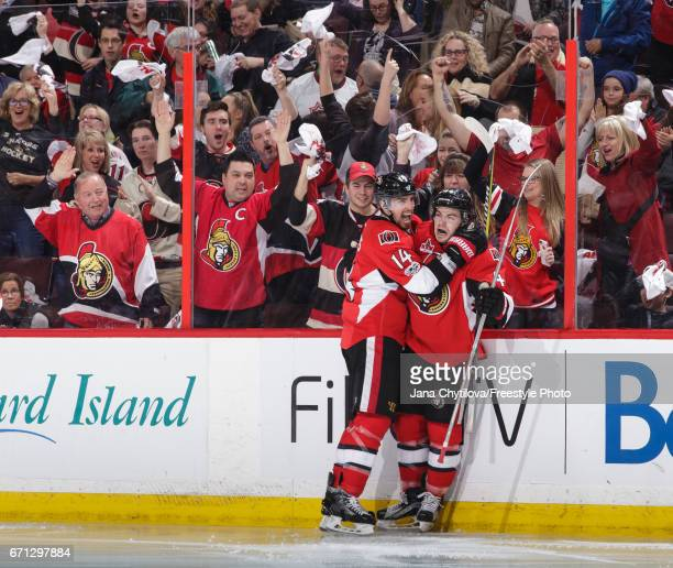 JeanGabriel Pageau of the Ottawa Senators celebrates his second period goal against the Boston Bruins with teammate Alexandre Burrows in Game Five of...